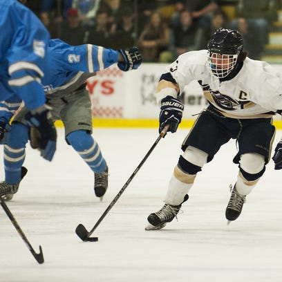 Essex's Brendan Gleason (3) skates down the ice with