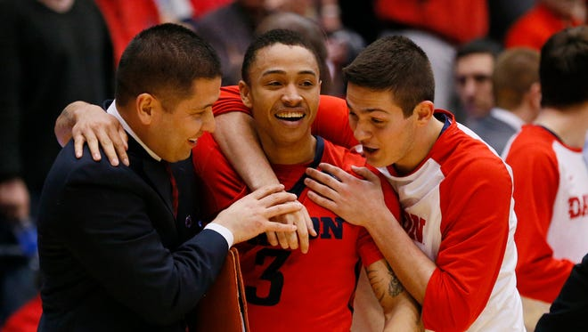 Dayton Flyers guard Kyle Davis (3) celebrates with a staff member and teammate after the win over Boise State Broncos.