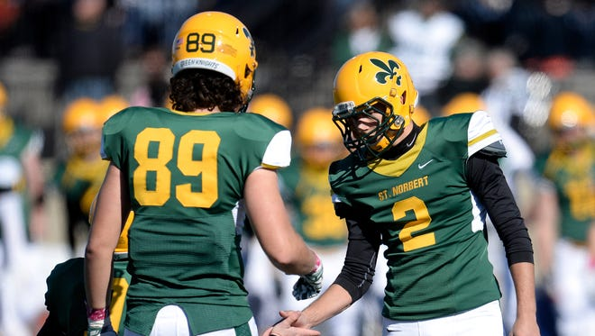 St. Norbert kicker Randy Hill (2) celebrates with teammates after booting a field goal against Ripon College on Oct. 18 at Schneider Stadium in De Pere. Hill has 22 field goals at SNC, one short of tying the school record.