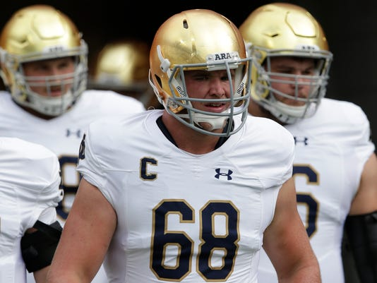 FILE - In this Oct. 7, 2017, file photo, Notre Dame's Mike McGlinchey (68) takes the field prior to an NCAA college football game against North Carolina in Chapel Hill, N.C. No. 13 Notre Dame is 5-1 halfway through a crucial year for coach Brian Kelley. Players say Kelley and the rest of the coaching staff became much more involved after last year's 4-8 debacle. (AP Photo/Gerry Broome, File)