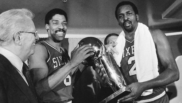Julius Erving and Moses Malone hold the NBA Championship
