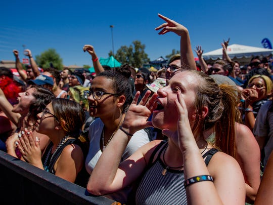 Fans cheer as Authority Zero performs on June 28, 2018, during the 2018 Vans Warped Tour at Ak-Chin Pavilion in Phoenix, Arizona. This is the final cross-country run for the 23-year-old music festival.