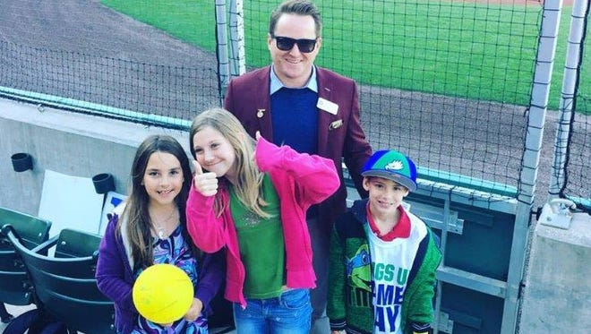 Max Haney, 34, bonds with Ciena Gibson, Presley Gibson and Greyson Grossman at a baseball game as part of Valerie's House program for children grieving the loss of a parent.
