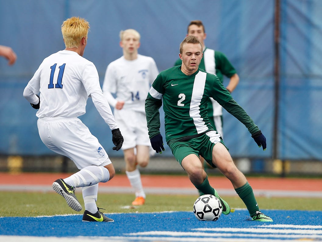 Solomon Schechter's Noam Goldberg (2) works around Mike Caruso (11) during their 1-0 win over Geneseo in the NYSPHSAA Class C state semifinal soccer game at Middletown High School on Saturday, Nov. 14, 2015.
