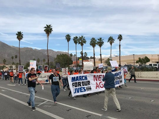 Students depart Palm Springs High School Saturday shortly