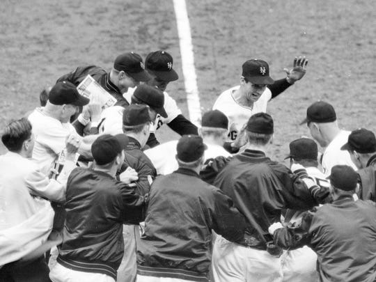 New York Giants teammates greet Bobby Thomson after his game-winning home run against the Brooklyn Dodgers on Oct. 3, 1951.