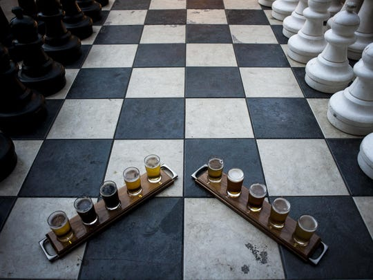 Patrons can play outdoor chess or enjoy a flight of beer on Bayern Brewing's patio in Missoula.