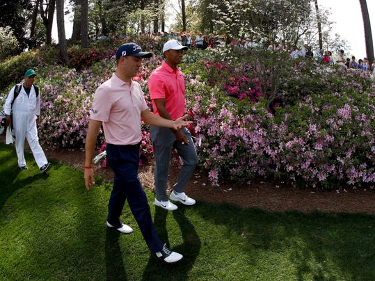 Justin Thomas, left, and Tiger Woods walk to the sixth green during practice for the Masters golf tournament at Augusta National Golf Club, Monday, April 2, 2018, in Augusta, Ga. (AP Photo/Charlie Riedel)