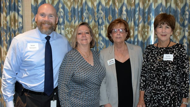 Sean Seevers, left, Debbie Crum, Patricia Knipper and Susie Calender at the Planned Giving Committee Breakfast at the Quail Valley River Club.