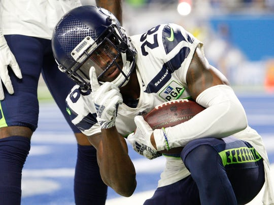 Oct 28, 2018; Detroit, MI, USA; Seattle Seahawks cornerback Justin Coleman (28) celebrates after making an interception during the fourth quarter against the Detroit Lions at Ford Field. Mandatory Credit: Raj Mehta-USA TODAY Sports