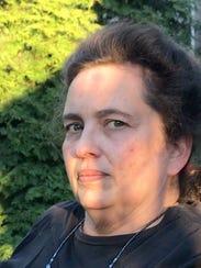 Lora Dean, a Highland Park neighborhood resident who