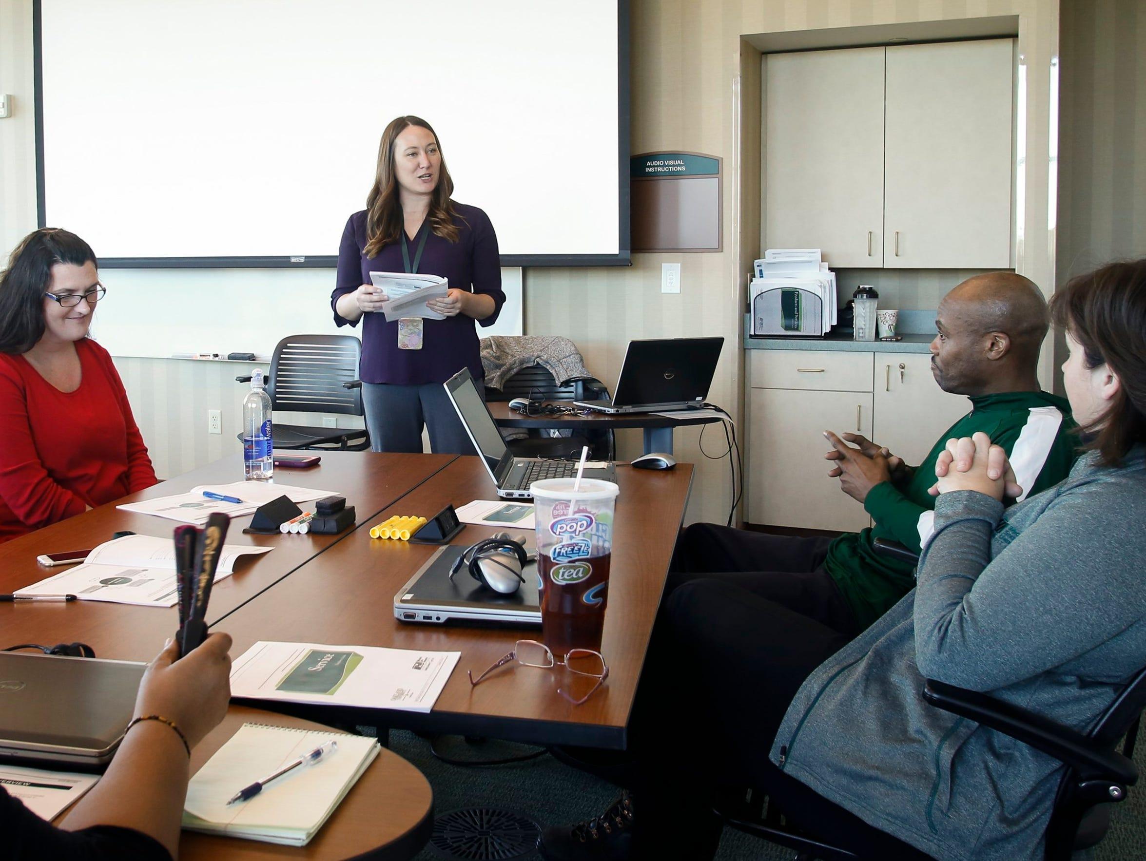 Jen Branch trains new employees Thursday, Nov. 10,