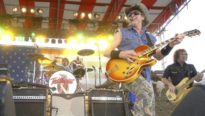 Ted Nugent performs to fairgoers in the grandstands at Marathon Park during the 2007 Wisconsin Valley Fair.