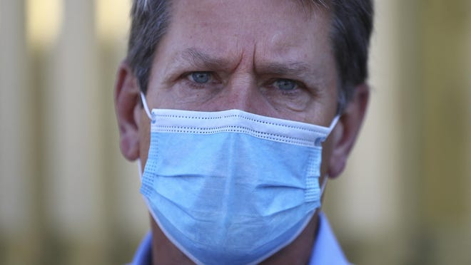 Georgia Gov. Brian Kemp wears a mask during a tour of the Phoebe North Campus of Phoebe Putney Health System in May in Albany.