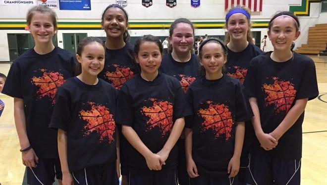 The Camarillo Junior Girls Dons team won its division at the Conejo Quakes Winter Classic.