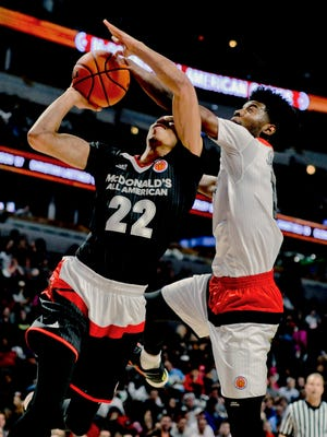 MSU target Josh Jackson, right, playing for the West team, blocks the shot of East forward Jayson Tatum  during Wednesday night's McDonald's All-American game in Chicago.