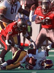 Tampa Bay Buccaneers defenders Charles Mincy left and Jeff Gooch (50) celebrate after sacking Pittsburgh Steelers quarterback Kordell Stewart (10) during first quarter action in the Pro Football Hall of Fame Game in Canton Ohio on Saturday Aug. 1 1998. (AP Photo/Amy Sancetta)