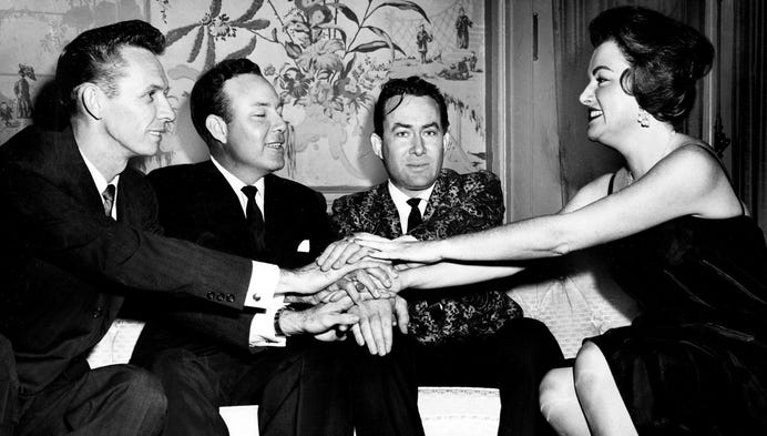 Frances Williams, right, Nashville representative of Broadcast Music Inc. (BMI), greets three songwriters who were honored at the BMI dinner Nov. 2, 1960. Mel Tillis, left, Jim Reeves and Don Gibson were honored at the Belle Meade Country Club.