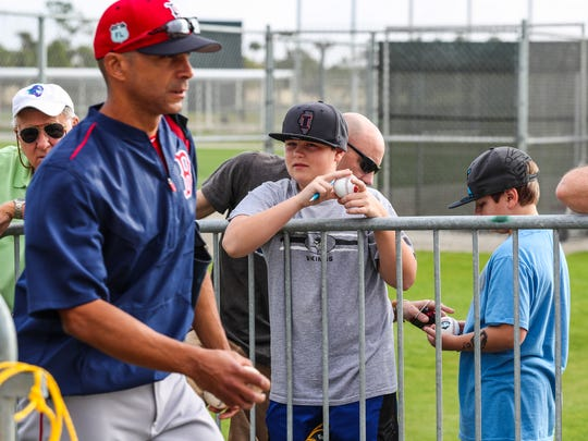 Red Sox fans, young and old, wait for the players to show up.  Spring Training give the fans a chance to get up closer to the players and interact with them more.