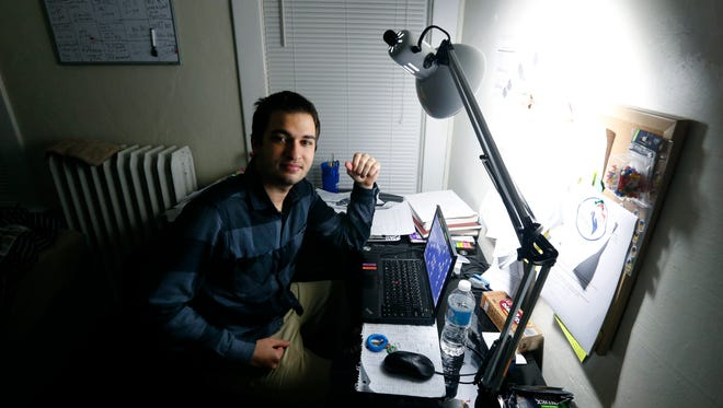 University of Rochester student Iyad Sayed Issa from Aleppo, Syria, in his apartment in Rochester.