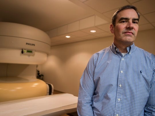 Todd Kummer, owner of Vermont Open MRI in South Burlington, with their MRI machine.