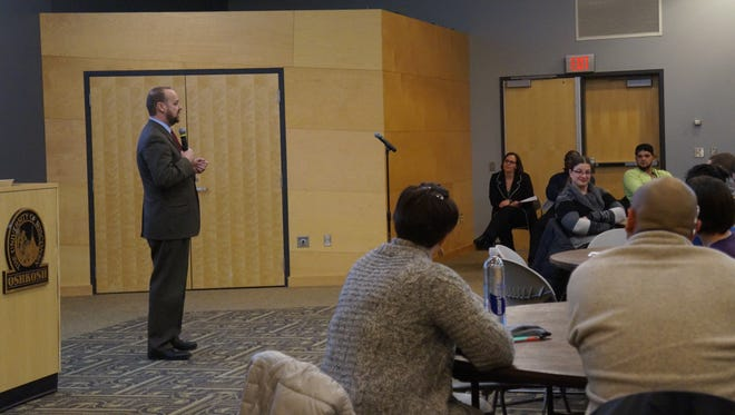 University of Wisconsin-Oshkosh Chancellor Andrew Leavitt speaks about personal experiences with the Muslim community Monday during a town hall meeting.