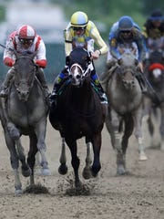 Classic Empire, with Julien Leparoux aboard, right,