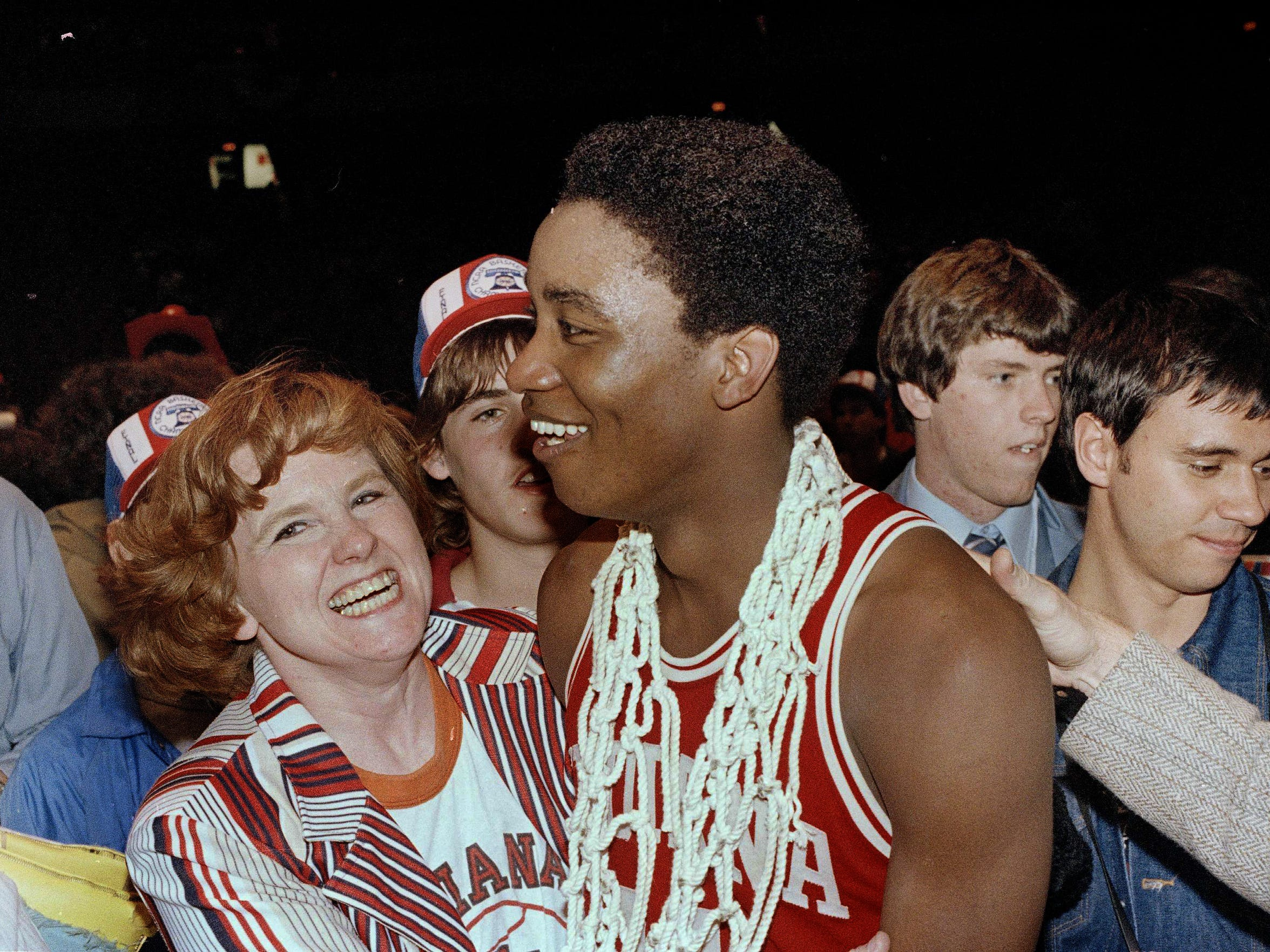 Isiah Thomas of Indiana University wears the net from the basket around his neck and is surrounded by fans after his team won over North Carolina, 63-50, in the final NCAA championship game, March 31, 1981.
