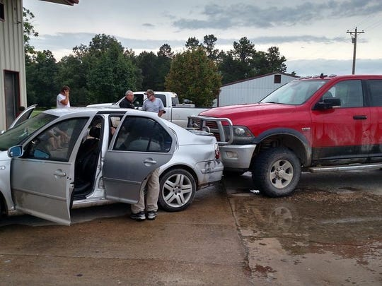 Pictured is the scene where a Dodge Ram pickup driven by Roger Peckenpaugh rammed a vehicle carrying a man, woman and young child.