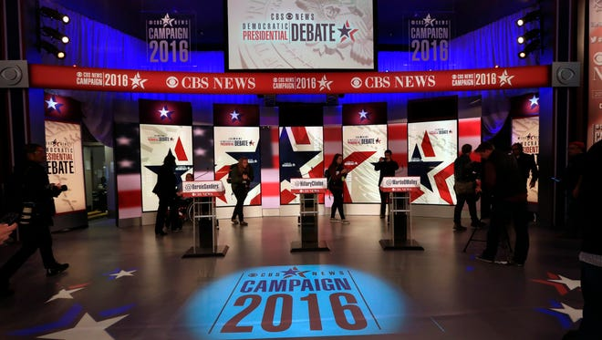 Members of the media check out the stage in the Sheslow Auditorium on Drake University campus before a Democratic presidential primary debate, Saturday, Nov. 14, 2015, in Des Moines, Iowa.