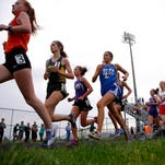 Runners, including Grand Ledge's Jenna Magness (1) and East Lansing's Stephanie Vanis (6), compete in the 3200 meter run Friday, May 20, 2016, in Holt, Mich.