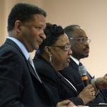 Artur Davis, from left, Ella Bell, Dan Harris and Todd Strange answer questions during a Montgomery Mayor Candidate Forum held at the downtown library in Montgomery, Ala., on Monday July 27, 2015.
