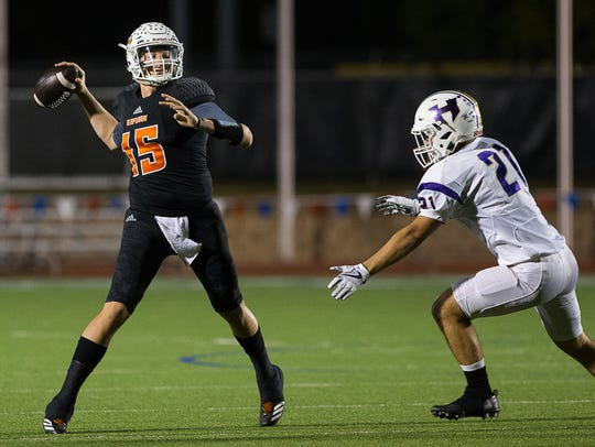 Refugio's quarterback Jared Kelley throws a pass during