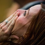 Tanisha Sorenson, sister of Travis Alexander, sobs as she hears the judge announce a hung jury in the Jodi Arias sentencing retrial on March 5, 2015.