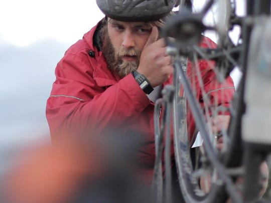 """Chandler Wild is shown fixing his bike during the feature-length documentary """"Mount Lawrence."""" The documentary will be shown Friday at the Englert Theatre as part of the Landlocked Film Festival."""