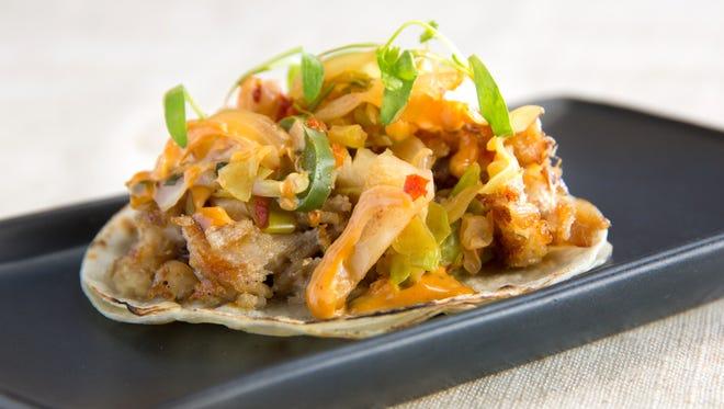 The pork belly taco at Crujiente Tacos.