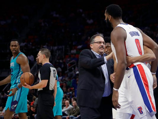 Detroit Pistons head coach Stan Van Gundy and teammates hold back center Andre Drummond (0) from Charlotte Hornets center Dwight Howard (12) during the second half of an NBA basketball game, Wednesday, Oct. 18,2017, in Detroit. (AP Photo/Carlos Osorio)