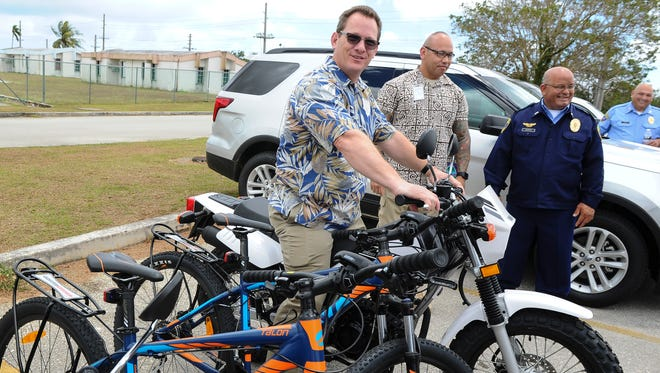 Lt. Gov. Ray Tenorio recalls he experiences when he served as a Guam police officer riding a motorcycle as he sits atop one of two Yamaha TW200 motorcycles donated to Guam Police Department's Dededo Precinct on March 30. The Guam Home Center donated a pair of Yamaha TW200 motorcycles and two Giant Talon mountain bikes were donated by JMI-Edison to the law enforcement agency to aid in its ability to patrol and deter crime.