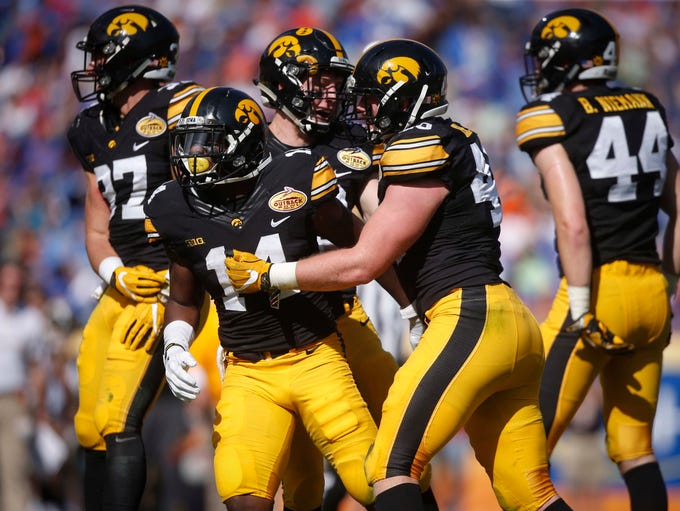 Members of the Iowa defense celebrate an interception