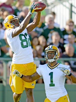 Receivers Jimmy Hunt (82) and Adrian Coxson (1) during a drill at Green Bay Packers Training Camp at Ray Nitschke Field July 30, 2015.