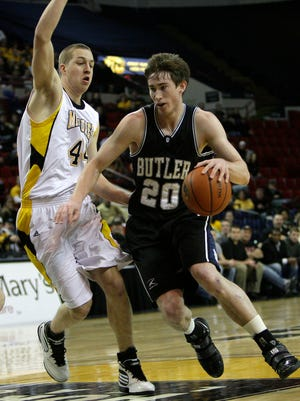 Butler's Gordon Hayward drives against UWM's Ryan Haggerty during a game at U.S. Cellular Arena on January 31, 2010.