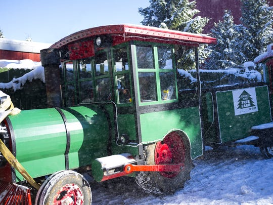 A tractor dressed up like a locomotive takes families to see Santa at the Peacock Road Family Farm, Nov. 21, 2015.