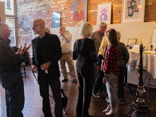 Friends and family gather at a fundraiser for artist Barbara Morris Sunday, Oct. 23, 2016.