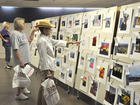 Visitors look at the photography entries at last year's West Texas Fair & Rodeo.