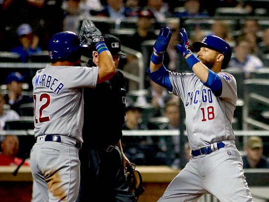 Chicago Cubs second baseman Ben Zobrist (18) celebrates