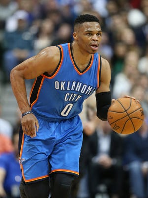 Oklahoma City Thunder guard Russell Westbrook drives the ball up-court against the Dallas Mavericks at American Airlines Center. The Thunder beat the Mavs 116-103.