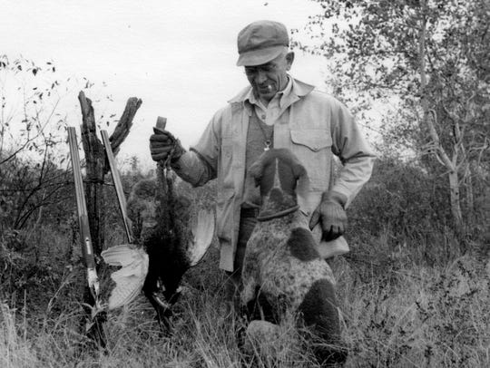 Aldo Leopold is shown in this 1943 photo with his dog