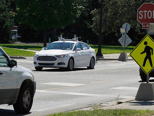A Ford Fusion Hybrid autonomous test vehicle navigates