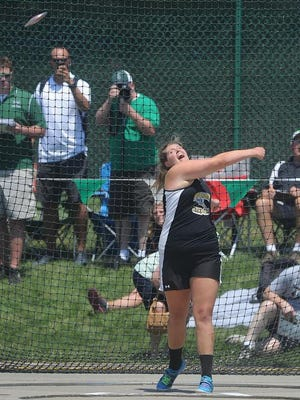 Tri-Valley's Kaylee Antill throws in the girls discus during the Division I state meet in high school. Antill is being inducted into the Tri-Valley Athletic Hall of Fame on Friday.