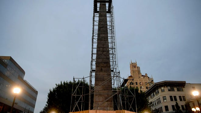 A scaffolding surrounds Vance Monument in Pack Square July 10, 2020 as the city prepares to shroud the obelisk in downtown Asheville.